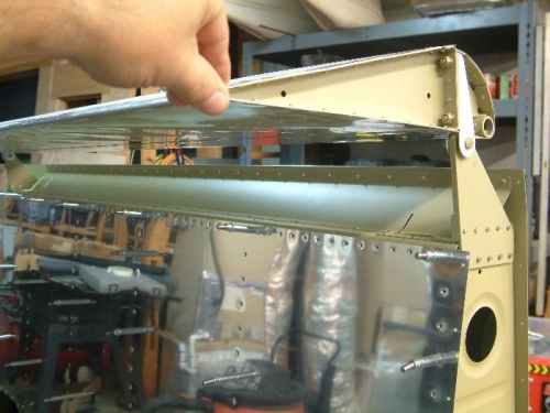 Aileron gap fairong riveted to spar and top skin