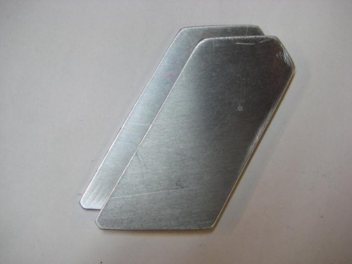 A pair of shims for the lower engine mount