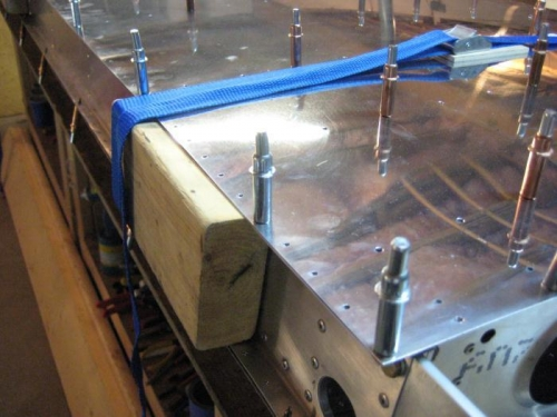 2x4 in rear spar to keep straps from crushing the flanges of the rear spar.