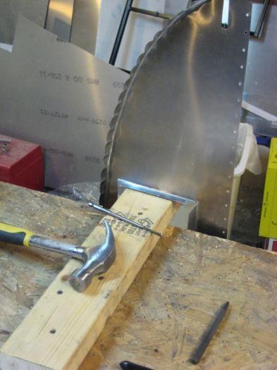 Setup for making holes in flanges