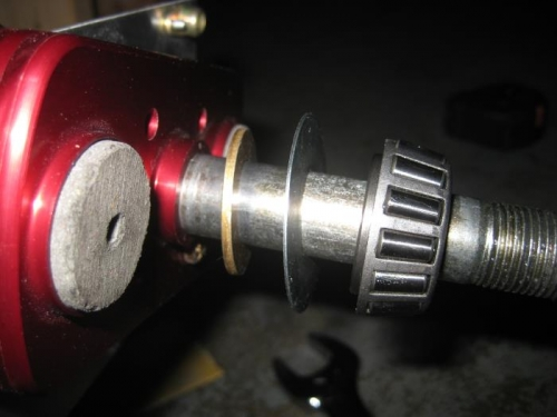 Spacer (washer), dust cover, bearing.