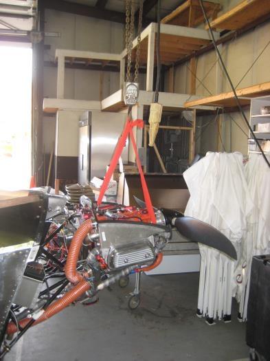 Engine hoist holding the engine up and forward.
