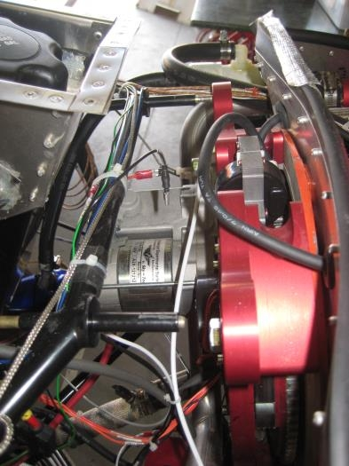 Engine mount to the left, engine off the mount, to the righg.