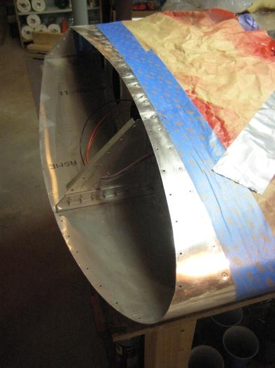 Masking the wing tip for paint