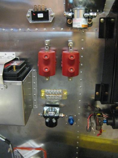 Head-on view. Master relay at top right; starter relay at bottom left.