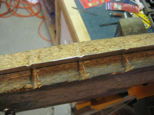 Pre-fluting prior to bending the flanges over
