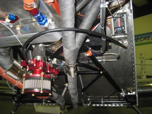 Black throttle cable out firewall and curving to carb.