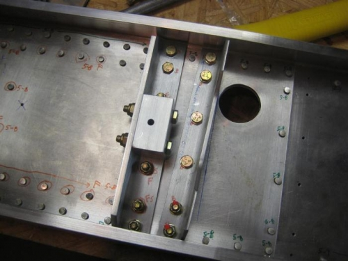 Angles and wing attach block with bolts and screws