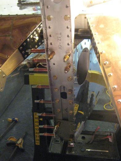 Tail post with bolts being loosely installed
