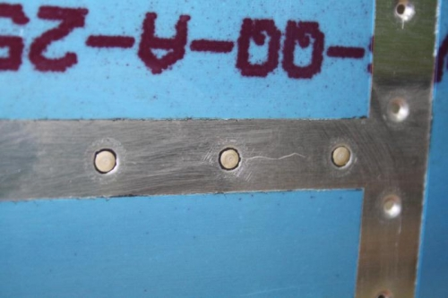 Rivets with Proseal visible.