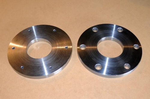 Faced in lathe and drilled initial holes