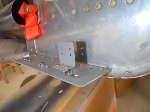 Bracket riveted to plate