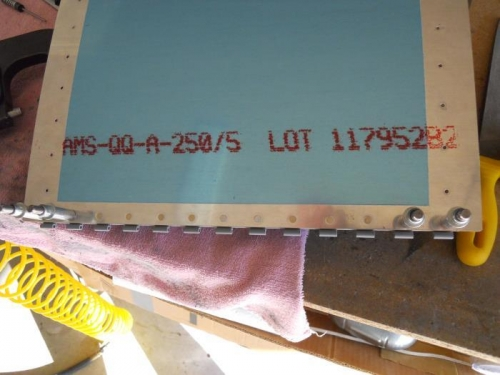 Riveting hinge/angle to skin