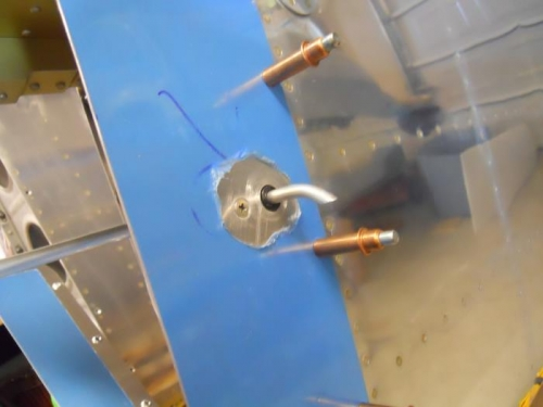 Curved and cut vent tube