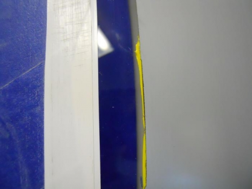 Tape trapped under edge of fairing