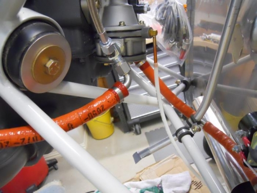 Lower end of breather tube, fuel lines to and from pump