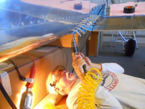 Me, drilling the flap fairing--got chips in gotee!