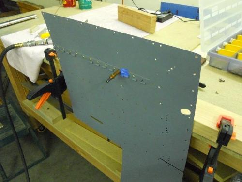 Riveting hinge on left floor panel