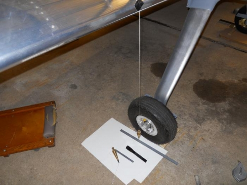 Measuring distance between wing and axle