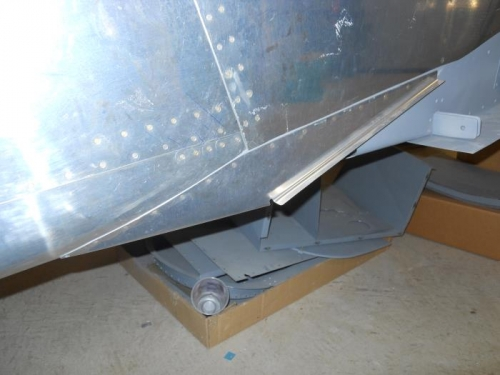 Flap fairing riveted to fuse