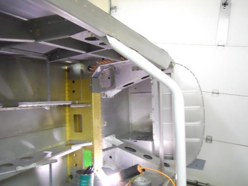 Fuselage rolled on side for easier access