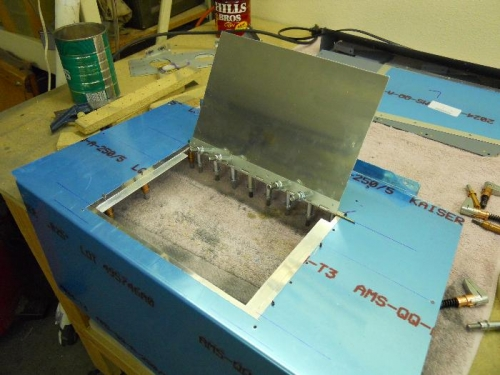 Drilled hinge to hatch lid