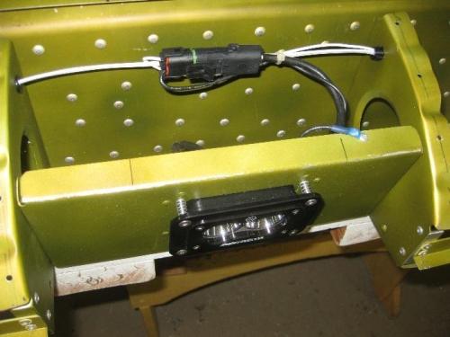 L/L Spots spring mounted for adjustment.
