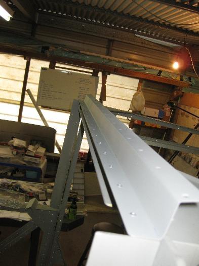 Part F182 installed onto the forward upper cabin cross member.