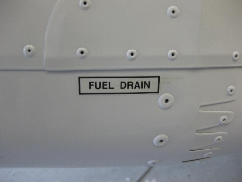 A total of 6 fuel drain stickers applied.