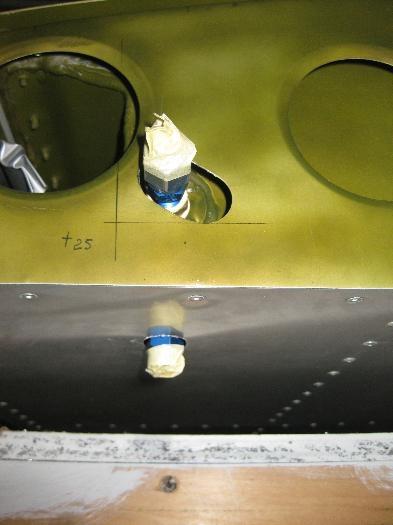Fuel drain & rear tank pickup fittings.