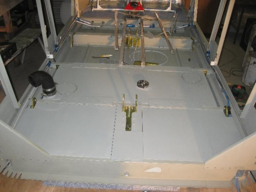 Stowage hatches behind the rear seats assembled