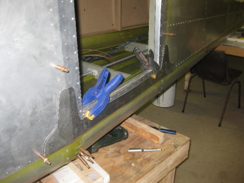 Splice plate similar to the right side.