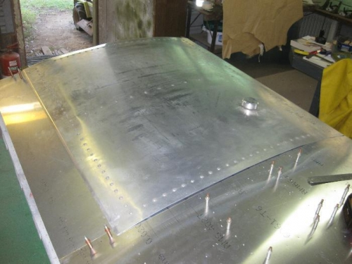Right side fuel tank positioned for marking the securing screw holes.