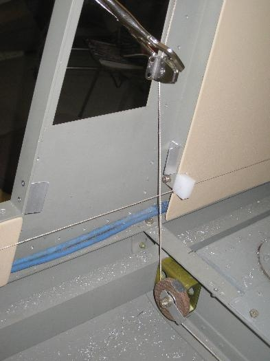 Placement of guide roller for aileron cable to cabin side.