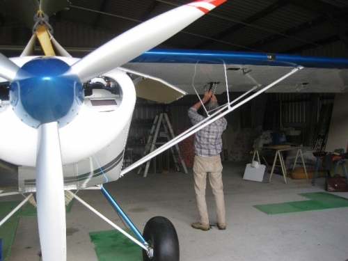 Ron doing the second check of the aileron bellcranks & rod ends.