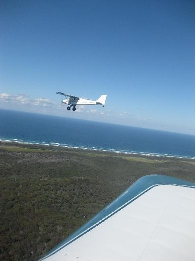 Burning Avgas over Stradbroke Island.