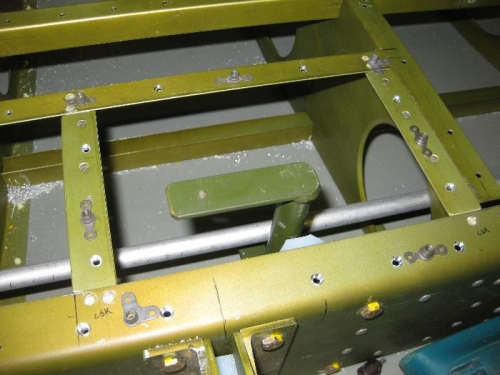 Positioning plate nuts for the access panel screws