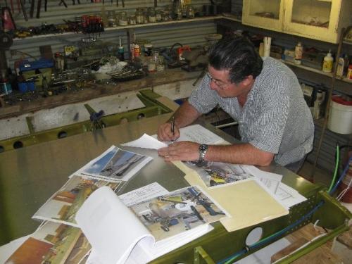 Howard Doing the paperwork