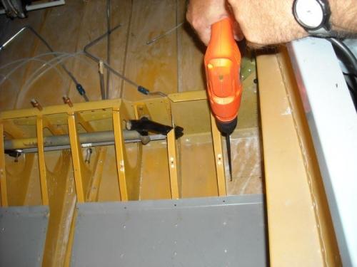 Drilling mount holes for servo bracket.